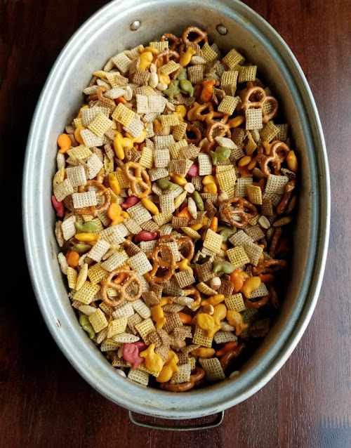 large roasting pan filled with chex mix ingredients ready to bake