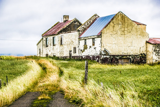 An abandoned farmhouse on the side of the road outside of Reykjavik, Iceland with the Color True Grit Lightroom Preset applied