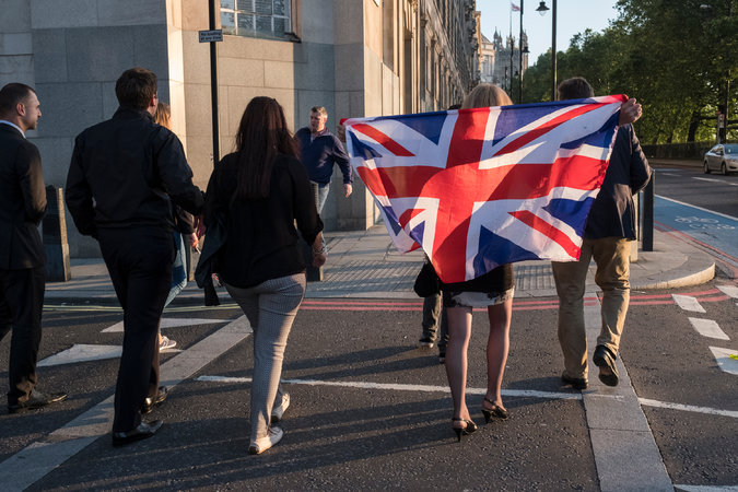 Supporters of the campaign to leave, one draped in Britain's Union Jack,  in central London on Friday.