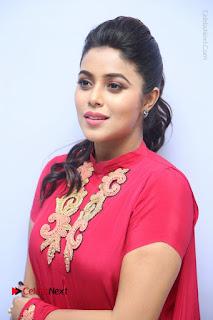 Actress Poorna Latest Stills in Red Dress at Rakshasi First Look Launch  0010.JPG