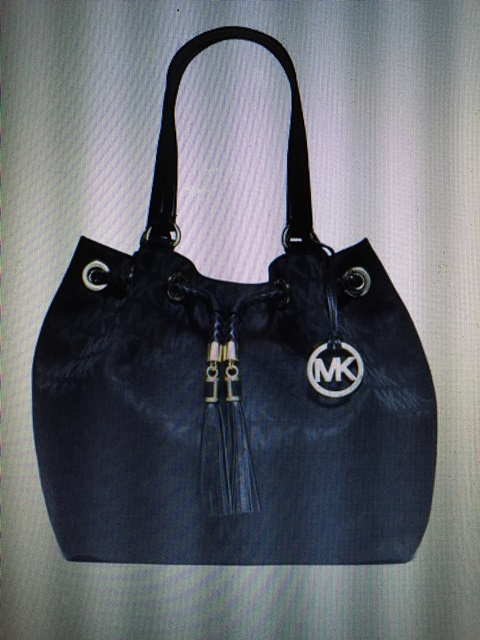 7a7686c4419979 Eventually, the personal shopper spotted the said bag and asked the stylish  sales assistant to hold up the two Michael Kors bags just for me to  estimate the ...