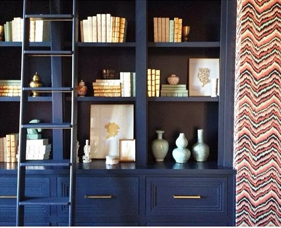 Jennifer Latimer 24K gold coral painting print styling bookcase built ins white navy gold