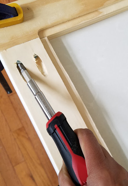 using a Milwaukee screwdriver with square drive bit for assembling cabinet door frames with pocket hole joinery