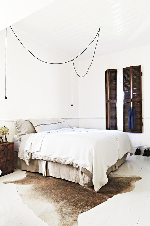 Bare bulb pendant lamps as bedside lighting