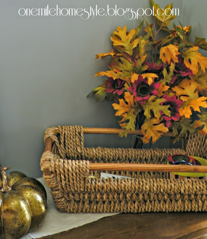 Entryway fall decor - woven basket and gold pumpkin