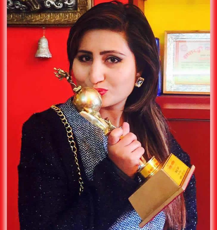 Anju Panta clinching Hits FM Award