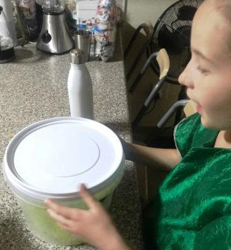 Girl opening up bucket with Nurchum hatch egg