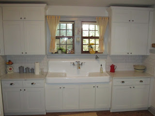 Beautiful white farm sink in vintage white retro kitchen in Lombard, Illinois