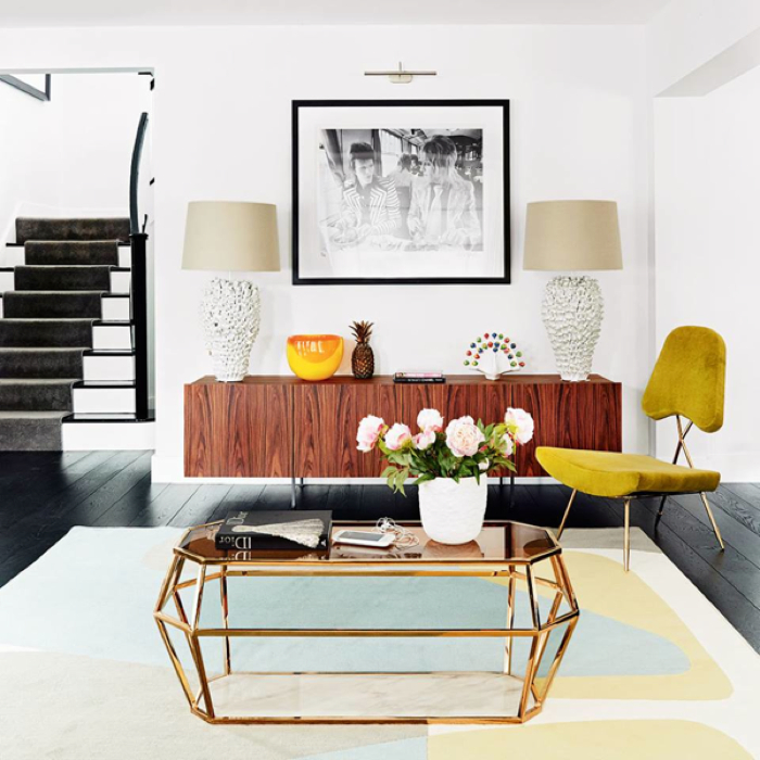 Glamorous living room. Love the brass details - design addict mom