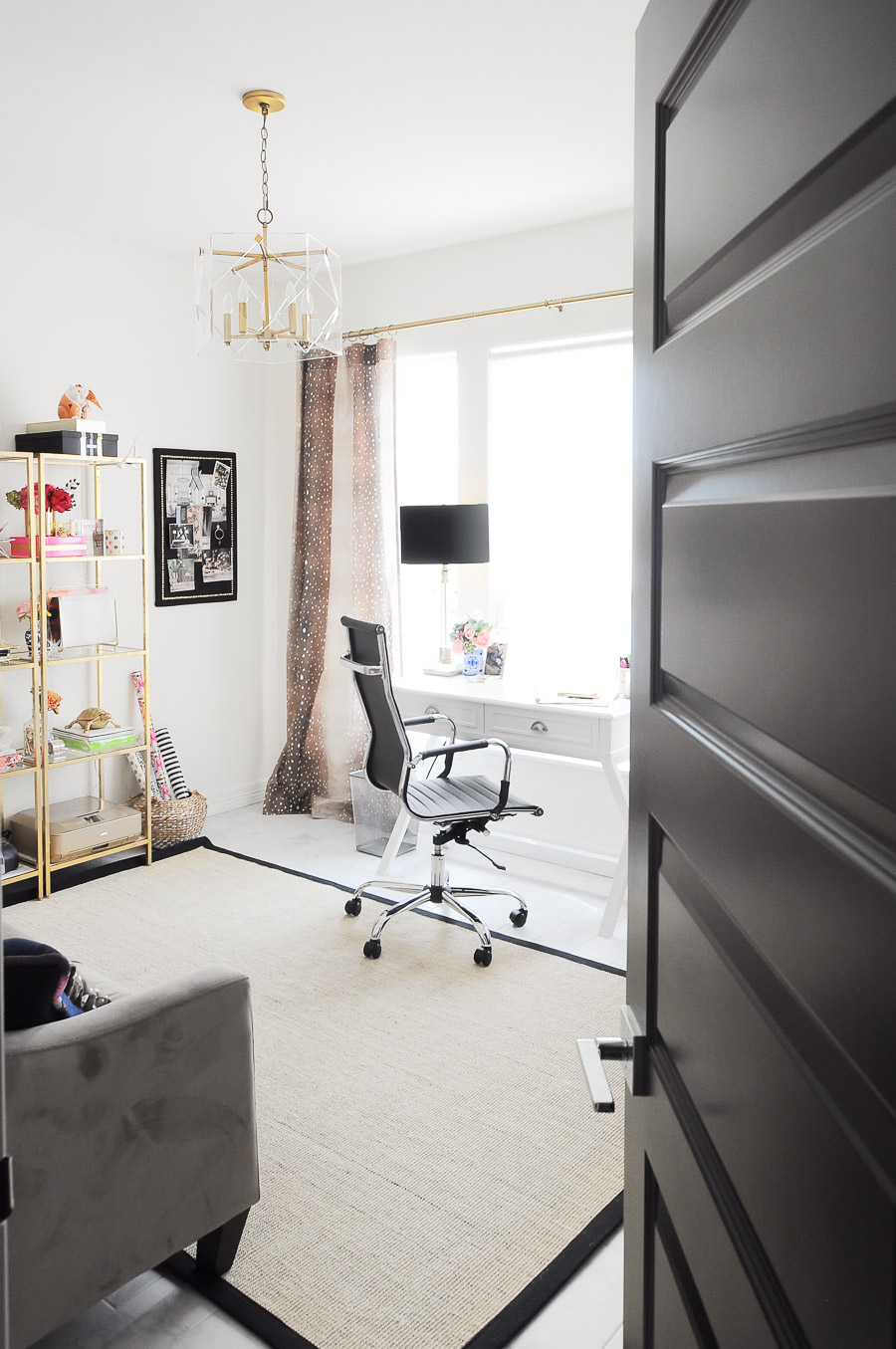 Bright white and gold home office makeover with fawn curtains, gold etageres, and a sisal rug