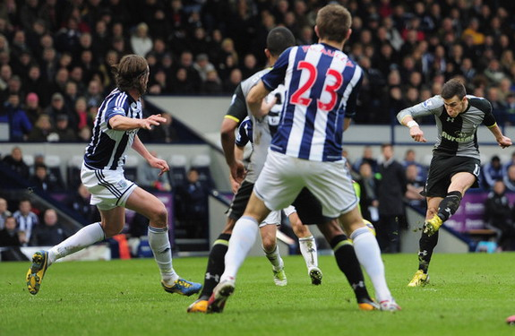 Tottenham player Gareth Bale shoots to score the winner against West Bromwich Albion