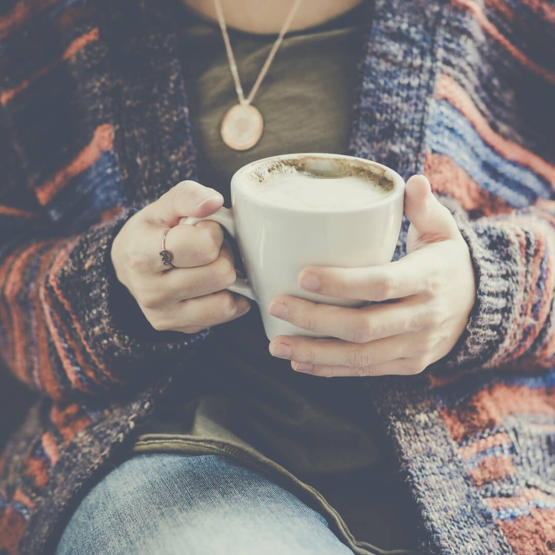 5 Reasons You Should Take A Break From Parenting - because we all need a break sometimes don't we? | A woman sits with a latte in her hand.