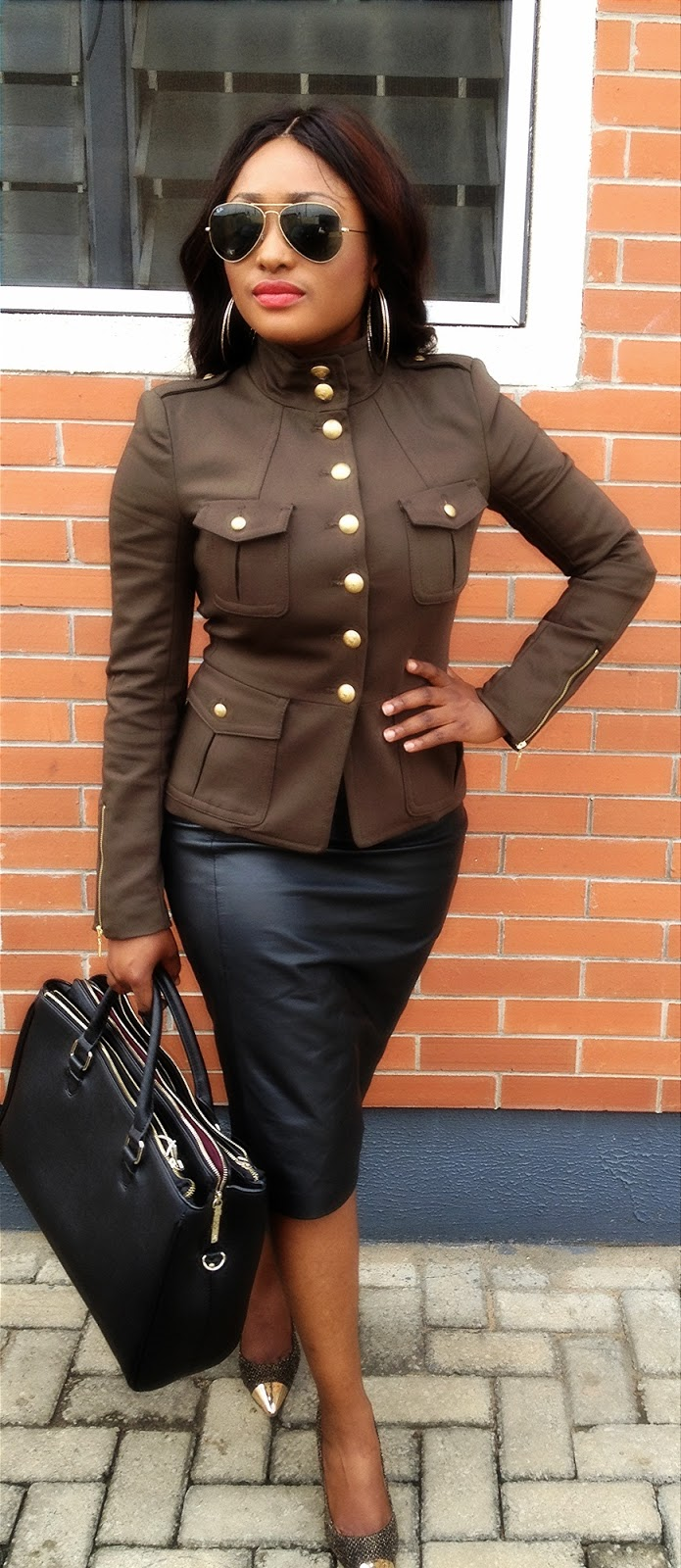 b231ec2e63 It has this expensive edgy look..I'm wearing a military jacket with gold  button details on a genuine leather skirt ... Don't y'all love this look?
