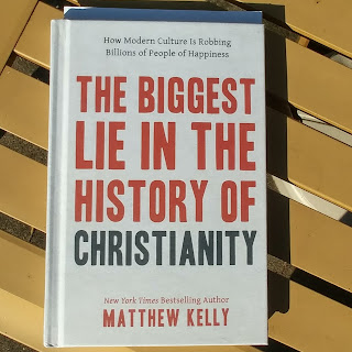 "Picture of the book ""The Biggest Lie in the History of Christianity"" (Matthew Kelly) on a patio table."