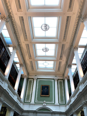 Looking up at the ceiling skylights and columns of the Linnean Society's library