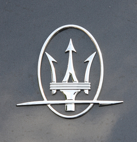 Car With  Prong Logo