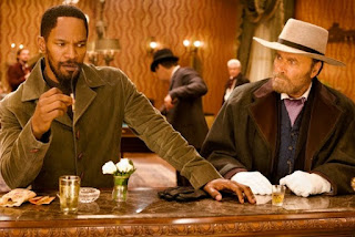 Franco Nero making a special appearance in Django Unchained, sitting alongside Django (played by Jamie Foxx), bar scene, Directed by Quentin Tarantino