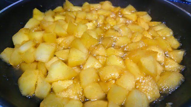 softened apples in a pan with cinnamon for apple pie