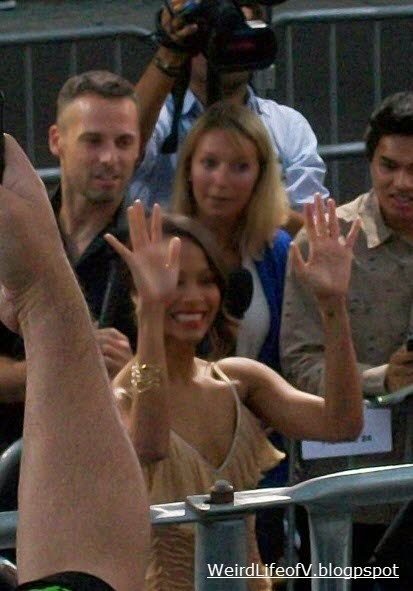 Zoe Saldana waving to the fans in the bleachers