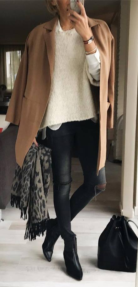 how to style a printed scarf : nude coat + sweater + black skinnies + boots + bag