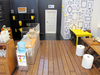 Modern dolls' house miniature cafe.