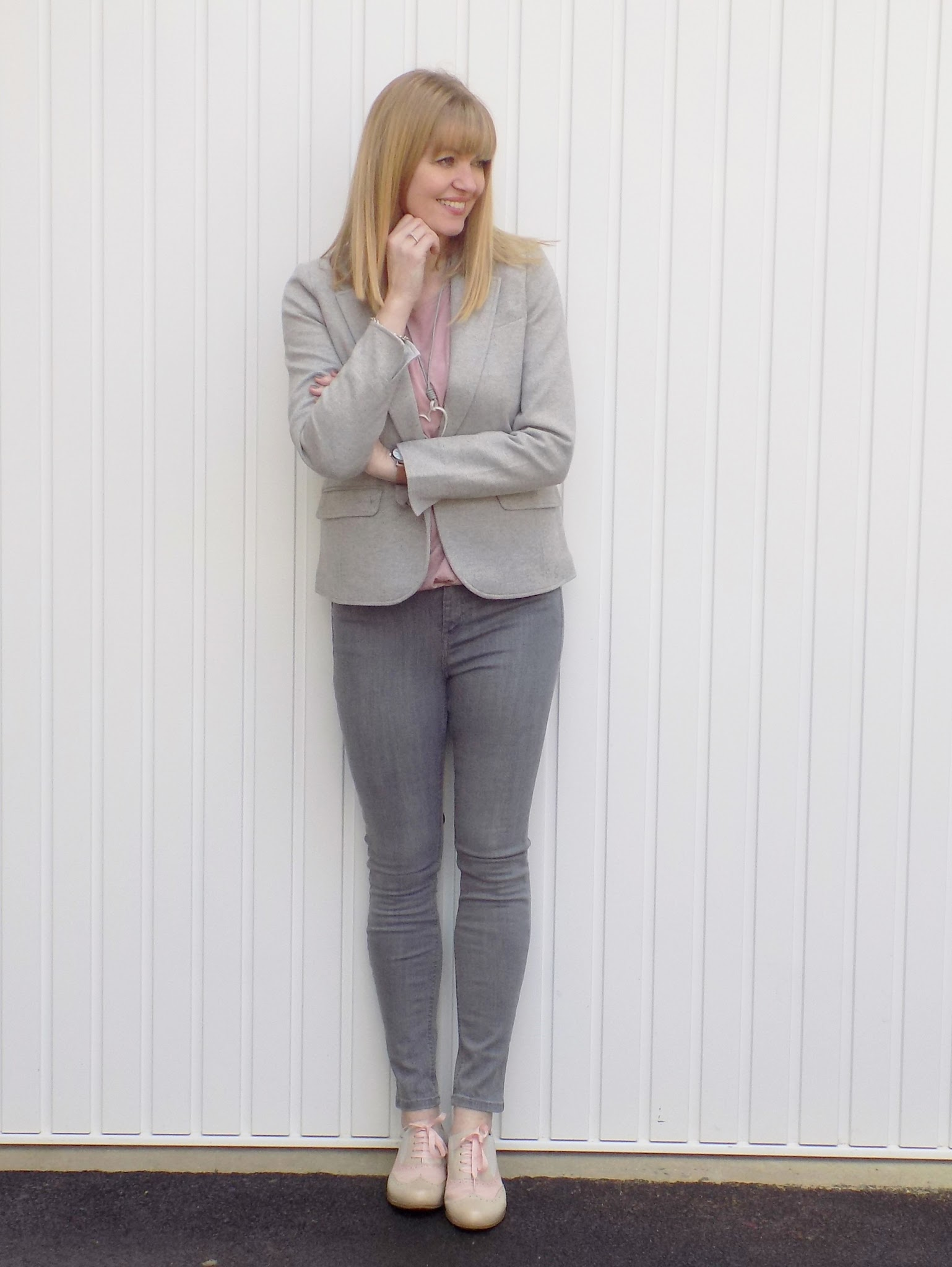 Grey jersey herringbone blazer with grey skinny jeans and pink brogues