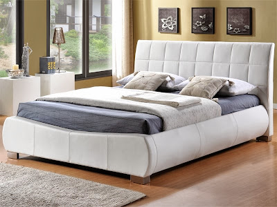 A stylish and modern white leather bedstead
