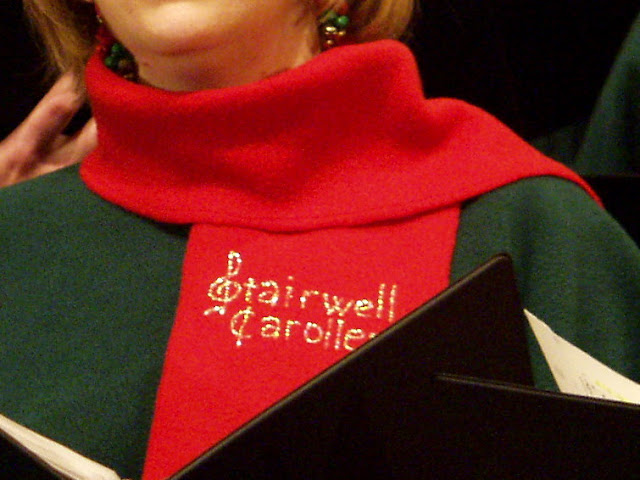 hand-lettered Stairwell Carollers on attached scarf of choir cloak