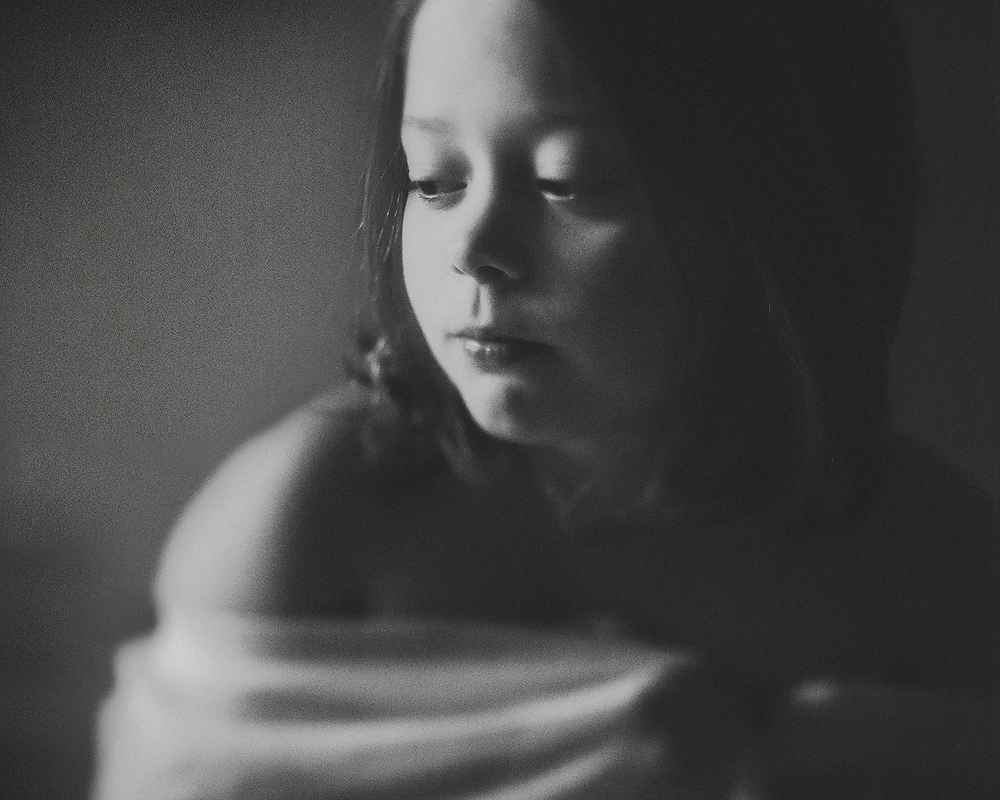 fine art black and white film portrait of a girl captured with a tilt shift lens