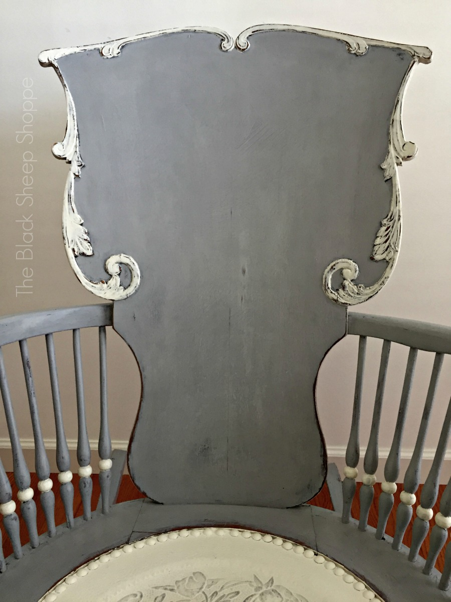 Seat back of painted rocking chair