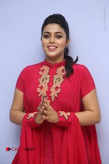 Actress Poorna Latest Stills in Red Dress at Rakshasi First Look Launch  0052.JPG