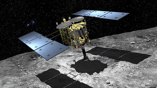 An artist's concept of Japan's Hayabusa2 spacecraft collecting a soil sample from the surface of asteroid Ryugu.