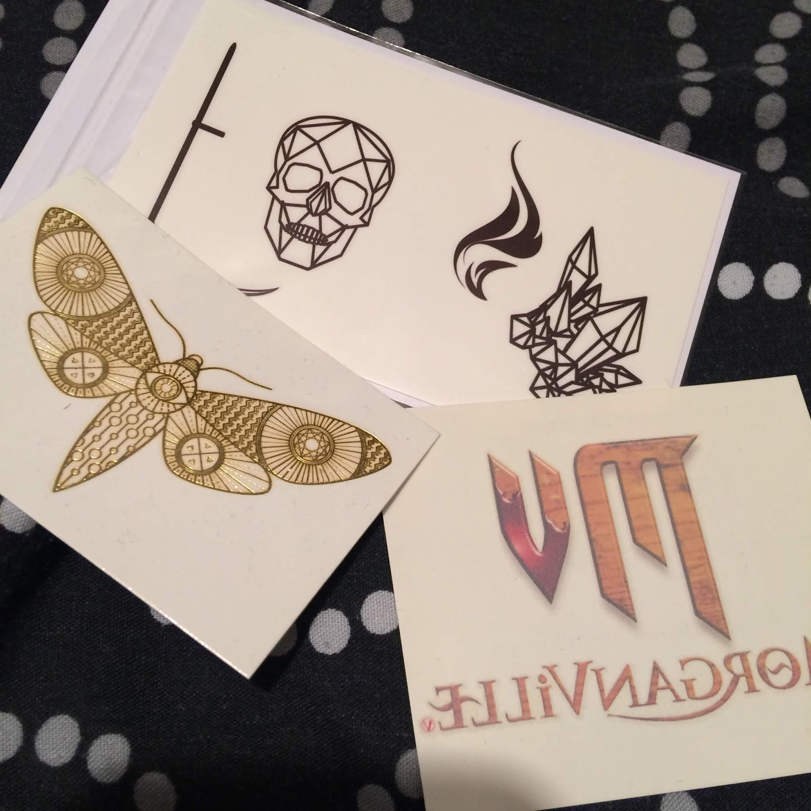 Temporary tattoos for Morganville Vampires series and Strange the Dreamer. The others are for an unknown book.