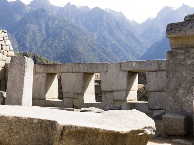 Iconic Machu Picchu Images: Sun rays coming through the trapezoidal windows at Machu Picchu