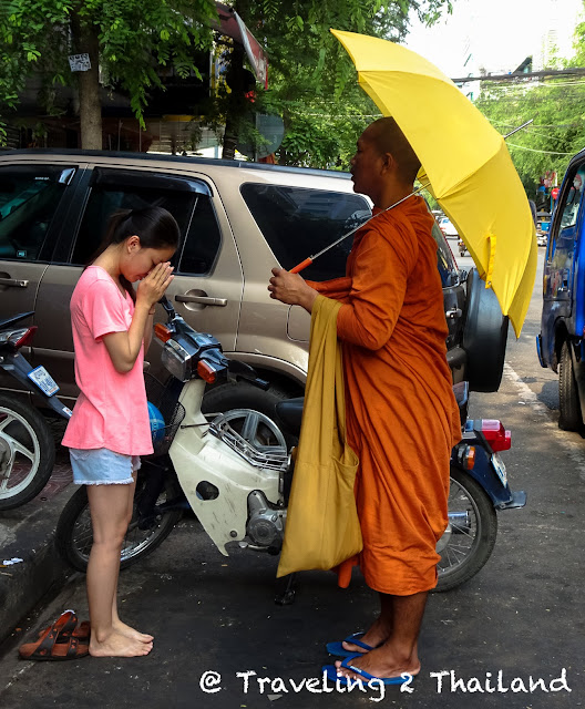 Blessing by a monk in Phnom Penh, Cambodia