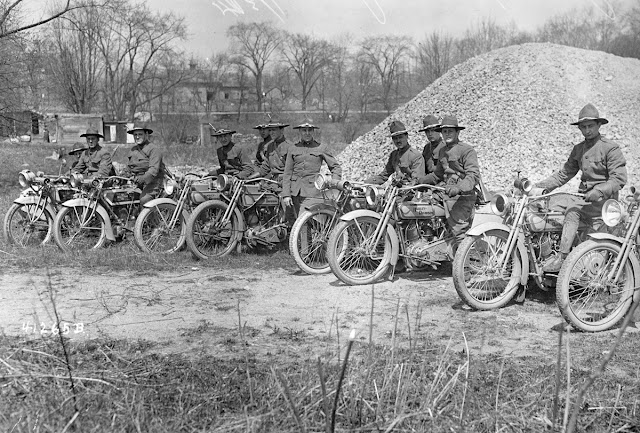 Men sit astride their Harley-Davidson motorcycles, part of the New York National Guard's Motorcycle Division, circa 1917.
