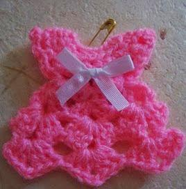 http://biguhandmade2.blogspot.ca/2010/05/batita-para-recuerdos.html
