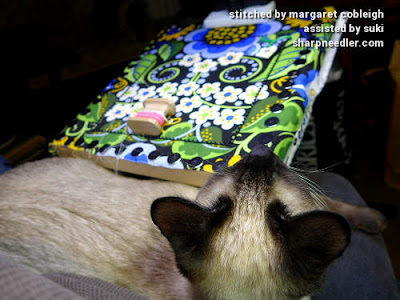 Siamese kitten being ignored by bead embroidery. (Wild Child Japanese Bead Embroidery by Mary Alice Sinton)