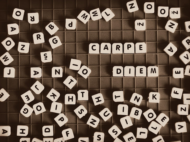 Scrabble tiles that say Carpe Diem