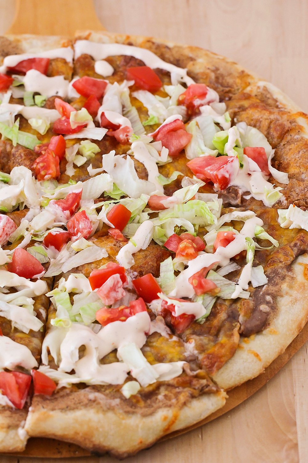 This cheesy tostada pizza is a delicious meatless meal that's super easy to make!