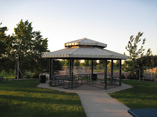 Paved walkway leading to a gazebo with benches.