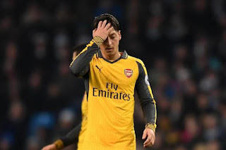 [Photos] Angry fans Attack Mesut Ozil After Etihad Defeat