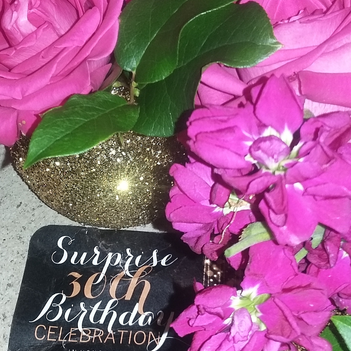 Madd designs the flowers bright pink roses and pink stock with greenery in gold sparkle vases izmirmasajfo Images
