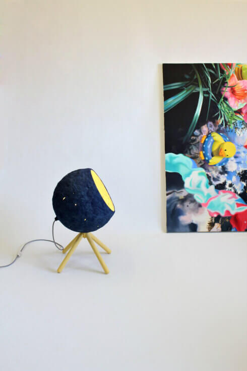 deep blue paper mache spotlight with wood base