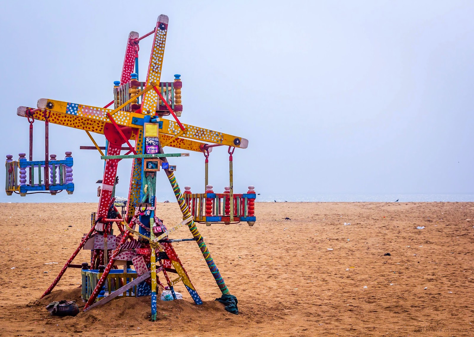 Picture of a Giant Wheel in Chennai beach. Picture taken in a cloudy day.