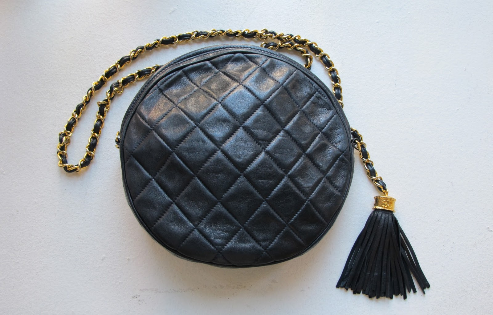 e8f3691a4deed3 Added to the illustrious stock of luxury handbags is this vintage Chanel  circle bag, with a playful fringe tassel zip up. This is a small, chic, ...