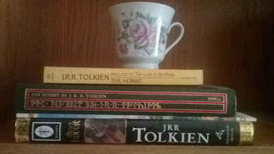 Stack of Hobbit books and tea cup, Bea's Book Nook