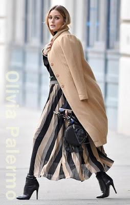 オリヴィア・パレルモ(Olivia Palermo)は、リレイテッド (Related)のコート、レベッカミンコフ (Rebecca Minkoff)のバッグ、ジミチュウ (Jimmy Choo)のアンクルブーツを着用。