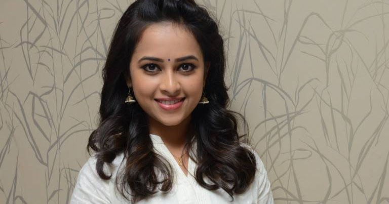 Hot Sexy Actress Sri Divya Latest Stills In White Dress At Movie Success Meet gallery