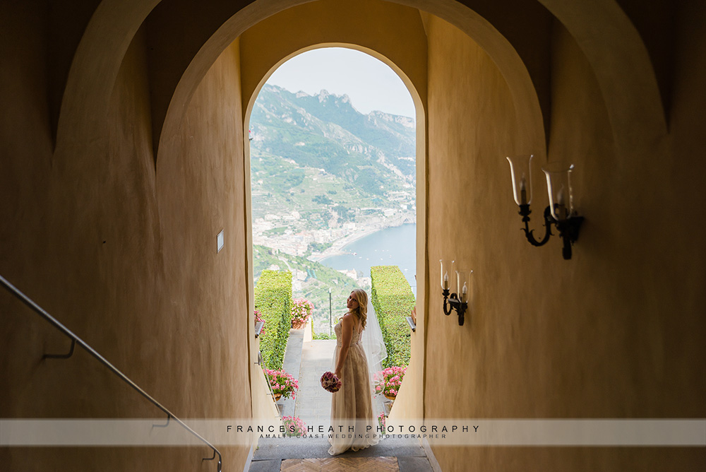 Bride portrait in an arch with Ravello view